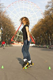 Young girl roller skates in the park Royalty Free Stock Images