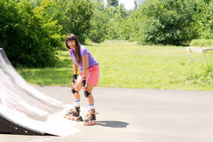 Young girl roller skating on a ramp Royalty Free Stock Photo
