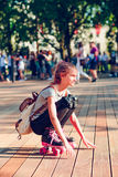 Young girl roller skating in a town Stock Photo