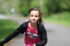Young girl rollerblading Stock Images