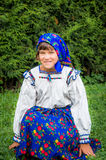 Young girl in romanian traditional dress. Maramures area, Romani. A young girl wearing a traditional dress from Maramures Royalty Free Stock Image