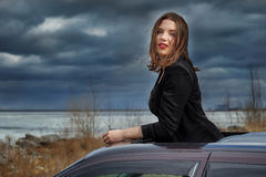 Young girl on the roof of the car Royalty Free Stock Photos
