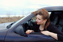 Young girl on the roof of the car Royalty Free Stock Photography
