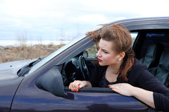 Young girl on the roof of the car Stock Photo