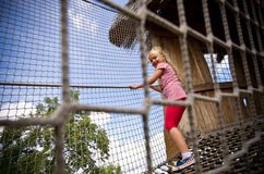 Young girl on rope ladder Stock Image