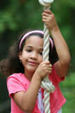 Young Girl On Rope Swing Royalty Free Stock Photos
