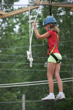 Young girl on a ropes course royalty free stock images