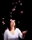 Young girl with rose petals Royalty Free Stock Photo