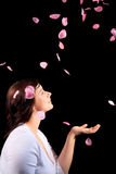 Young girl with rose petals Royalty Free Stock Photos