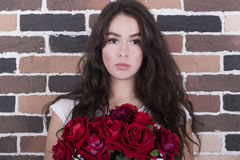 Young girl with roses Royalty Free Stock Images
