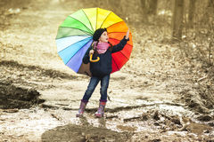Young girl in rubber boots in the forest Stock Photos