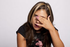 Young girl rubs her eyes Royalty Free Stock Photography