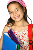 Young girl with rucksack and folders Stock Photo