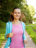 Young girl runner in the forest. Stock Images