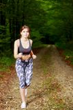 Young girl runner in the forest Royalty Free Stock Photography