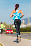 Young girl runner on the street. Royalty Free Stock Photos