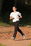 A young girl running Stock Photos
