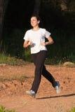 A young girl running. Outdoors enjoying the movement Stock Photos