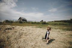 Young girl running around animal farm Stock Image