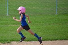 Young Girl Running Bases in Softball Royalty Free Stock Photos