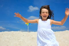 Young girl running on beach Royalty Free Stock Image