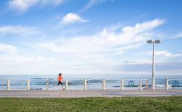 Young girl running in beach promenade on summer Royalty Free Stock Photos