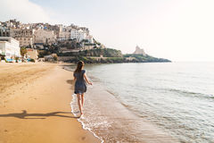 Young girl running on the beach of Sperlonga, Italy Royalty Free Stock Images