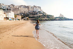 Young girl running on the beach of Sperlonga, Italy Royalty Free Stock Photos