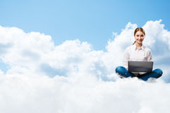 Young girl running in the clouds with a laptop Royalty Free Stock Photography