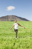 Young girl running in the field Royalty Free Stock Photo