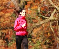 Young girl running in forest Stock Photos