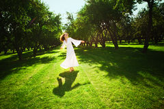 Young girl running in the garden Stock Photos