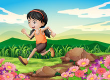 A young girl running hurriedly Stock Photo