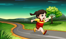 A young girl running Stock Images