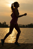 Young girl running jogging near water Royalty Free Stock Images