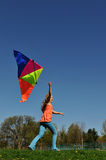 Young girl running with kite Royalty Free Stock Image