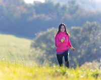 Young girl running on meadow Stock Images