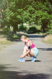 Young girl running in the morning in city park. Healthy fitness Royalty Free Stock Image