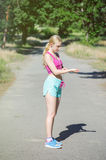 Young girl running in the morning in city park. Healthy fitness Royalty Free Stock Photos