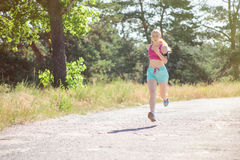 Young girl running in the morning in city park. Healthy fitness Stock Image