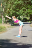 Young girl running in the morning in city park. Healthy fitness Stock Photography