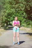 Young girl running in the morning in city park. Healthy fitness Royalty Free Stock Images