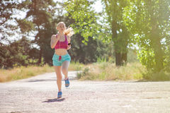 Young girl running in the morning in city park. Healthy fitness Stock Photos