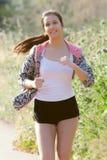 Young girl running Stock Photo