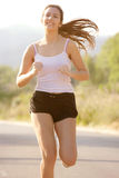 Young girl running Royalty Free Stock Photography