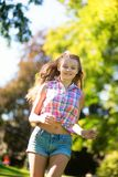 Young girl running outdoors Royalty Free Stock Photo