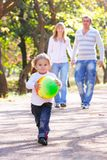 Young girl running in park Royalty Free Stock Images