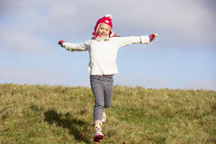 Young Girl Running In The Park Royalty Free Stock Photos