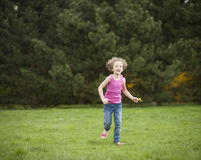 Young girl running through park in summer Royalty Free Stock Photography