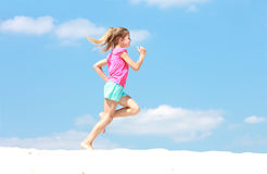 Young girl running in profile stock photos